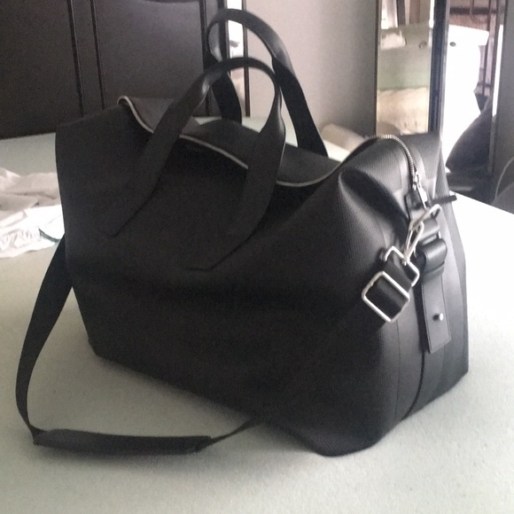 9c96089e41a Lacoste Handbags - Lacoste leather carry on/duffel bag